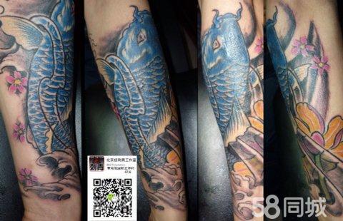 小臂鲤鱼佛头樱花纹身展示图片